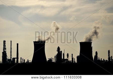 Silhouette Of Industrial Chimneys