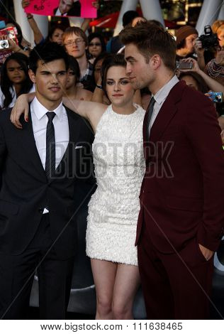 HOLLYWOOD, CALIFORNIA - June 24, 2010. Taylor Lautner, Kristen Stewart and Robert Pattinson at the