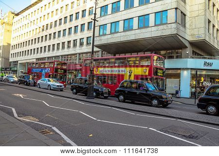 Typical Double Decker Buses In The Strand In London. One Of The Finest Streets In Europe. The Strand