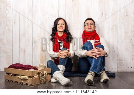 Happy young couple in Christmas style dress