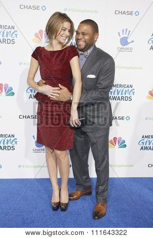 LOS ANGELES, CALIFORNIA - December 7, 2012. Maria Menounos and Anthony Anderson at the 2nd Annual American Giving Awards held at the Pasadena Civic Auditorium in Los Angeles.