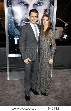 LOS ANGELES, CALIFORNIA - January 11, 2012. Dermot Mulroney and Tharita Catulle at the Los Angeles premiere of