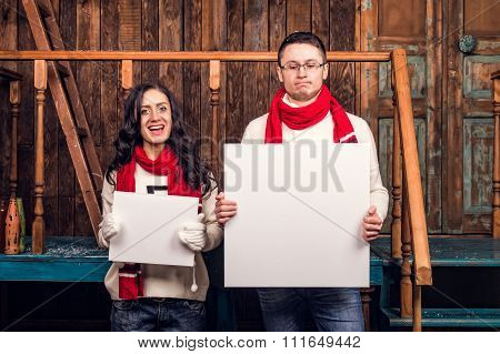 Couple hold blank signboard different sizes
