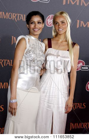 LOS ANGELES, CALIFORNIA - November 7, 2011. Freida Pinto and Isabel Lucas at the World premiere of