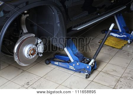 Car Repairs Service. The Car On Jacks