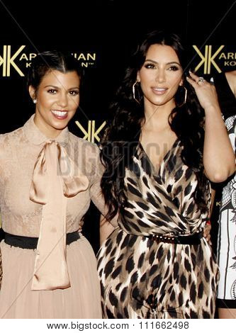 Kim Kardashian and Kourtney Kardashian at the Kardashian Kollection Launch Party held at the Colony in Los Angeles, California, United States on August 17, 2011.