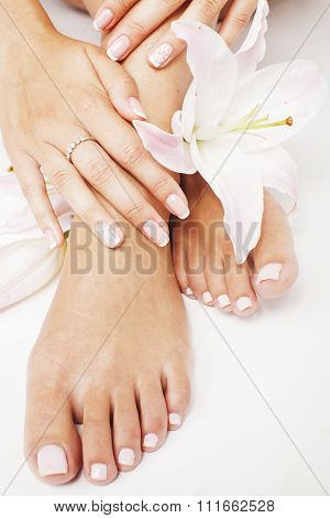 manicure pedicure with flower lily close up isolated on white perfect shape hands feet