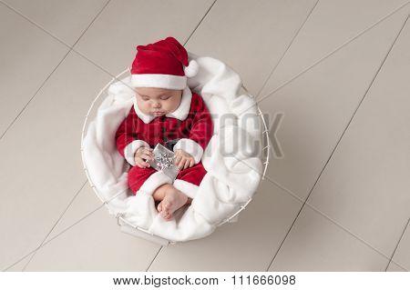 Baby Wearing A Santa Suit