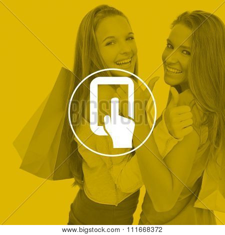 Rear view of two young women the thumbup with shopping bags against tablet pc
