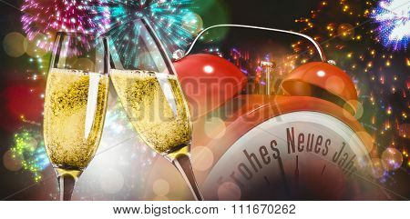 Champagne glasses clinking against colourful fireworks exploding on black background