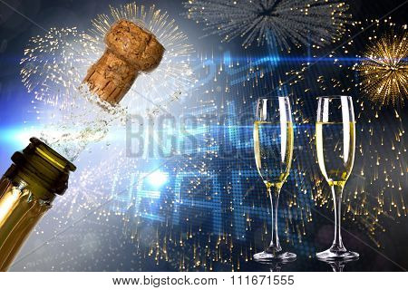 Close up of champagne cork popping against happy new year on tech background