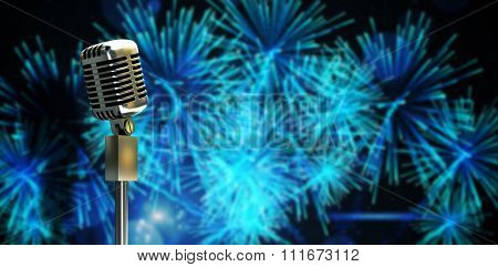 Digitally generated retro microphone on stand against digitally generated bright firework design