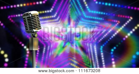 Digitally generated retro microphone on stand against digitally generated star laser background