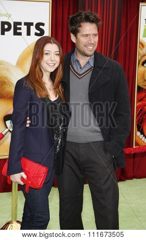 HOLLYWOOD, CALIFORNIA - November 12, 2011. Alyson Hannigan and Alexis Denisof at the World premiere of