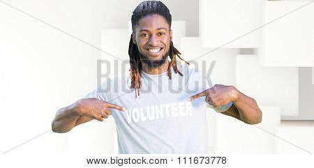 Happy volunteer in the park against abstract white design