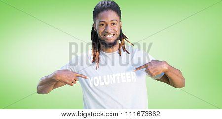 Happy volunteer in the park against green vignette
