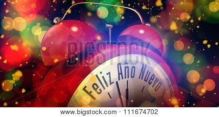 Feliz ano nuevo in red alarm clock against colourful glowing dots on black