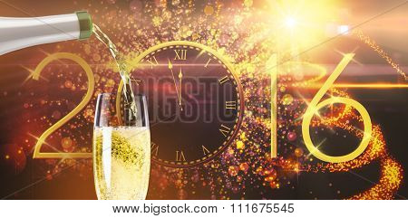Champagne pouring against new year countdown graphic