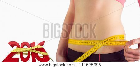 Woman measuring waist over white background against white background with vignette