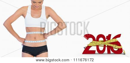 Smiling slim woman measuring her waist against white background with vignette