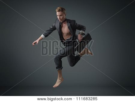 Handsome sporty businessman on studio background