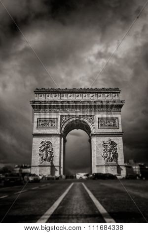 Arc the Triomphe with a grey and cloudy sky in Paris, France.  Black and white.