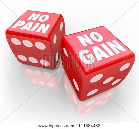 No Pain No Gain words on two red dice to illustrate taking a chance or betting on your odds in winning over difficult odds or luck