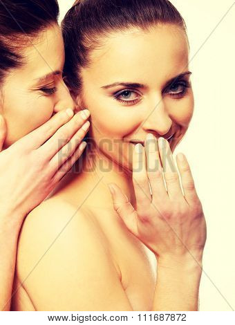 Beautiful two women sharing a secret.