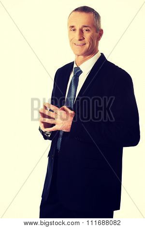 Confident businessman with clenched hands.