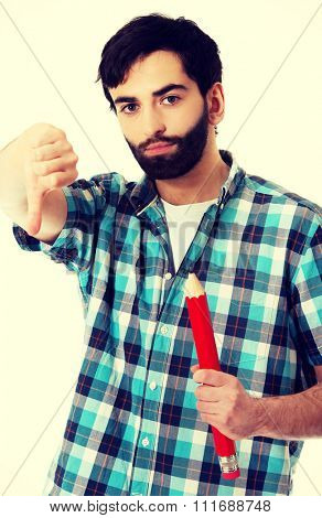 Young man with oversized red pencil and thumbs down.
