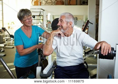 Two Senior People In Gym