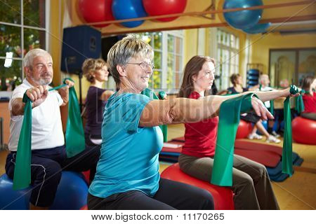 People Exercising With Latex Band
