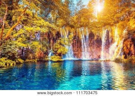 Majestic view on turquoise water and sunny beams.  Location famous resort Plitvice Lakes National Park, Croatia, Europe. Dramatic and vivid scene. Beauty world. Retro filter. Instagram toning effect.