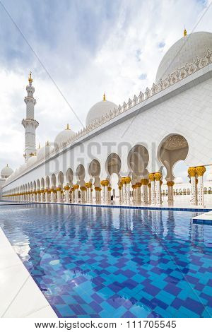 ABU DHABI, UAE -26 MARCH 2014: Sheikh Zayed Grand Mosque in Abu Dhabi, United Arab Emirates. Grand Mosque in Abu Dhabi is the largest mosque in United Arab Emirates for more than 40,000 prayers.