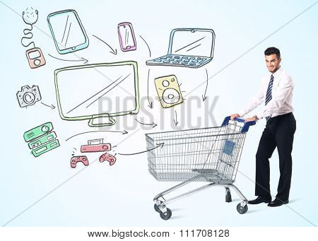 Businessman pushing a shopping cart drawn media devices coming out of it