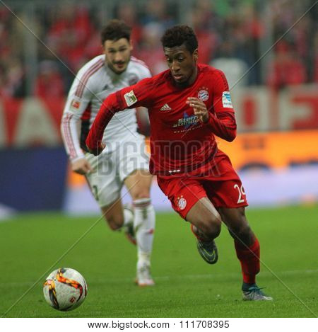 MUNICH, GERMANY - DECEMBER 12 2015: Kingsley Coman of Bayern Munich  during the Bundesliga match between Bayern Muenchen and FC Ingolstadt, on December 12, 2015 in Munich, Germany.