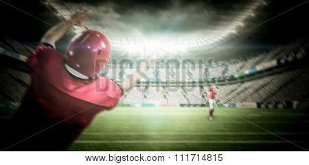 American football players against rugby stadium