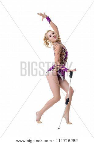 Cute rhythmic gymnast performs with maces