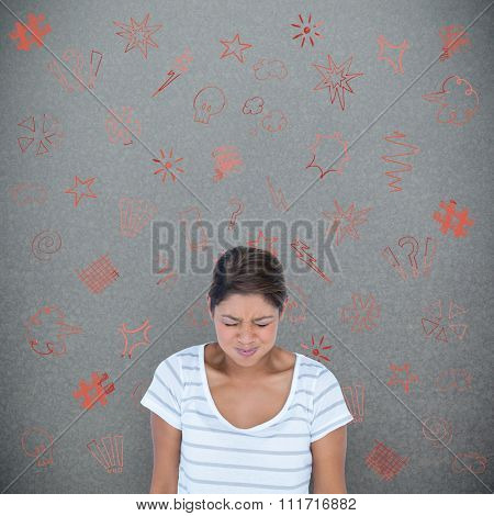 Angry woman with eyes closed against grey background