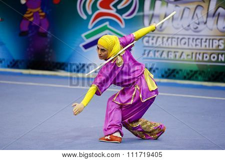 JAKARTA, INDONESIA - NOVEMBER 17, 2015: Hanieh Rajabi of Iran performs the movements in the women's Gunshu event at the 13th World Wushu Championship 2015 in Istora Senayan Stadium.