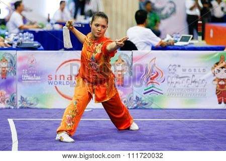 JAKARTA, INDONESIA - NOVEMBER 17, 2015: Eyin Poon of Malaysia performs the movements in the women's Jianshu event at the 13th World Wushu Championship 2015 in Istora Senayan Stadium.