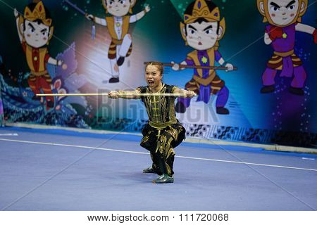 JAKARTA, INDONESIA - NOVEMBER 17, 2015: Ka Ying Yuen of Hong Kong performs the movements in the women's Nangun event at the 13th World Wushu Championship 2015 in Istora Senayan Stadium.