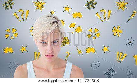 Upset woman looking at camera against grey vignette