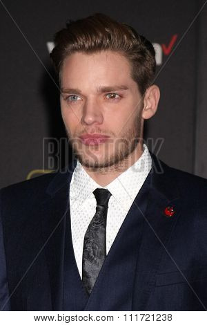 LOS ANGELES - DEC 14:  Dominic Sherwood at the Star Wars: The Force Awakens World Premiere at the Hollywood & Highland on December 14, 2015 in Los Angeles, CA