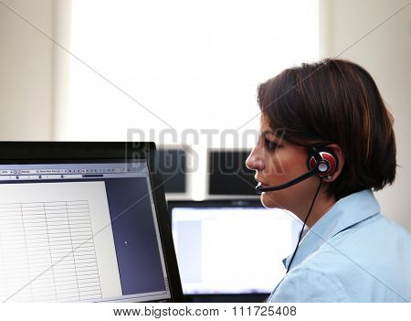 a woman working at a public safety answering point call center during the daytime
