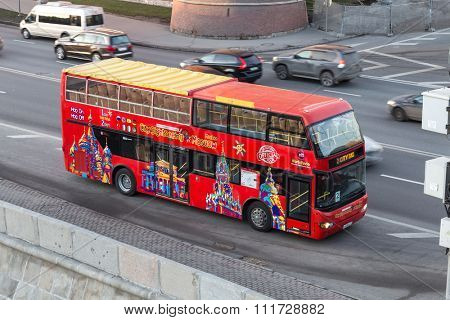 Moscow, Russia - December 11, 2015:  Red tour bus near the Moscow Kremlin