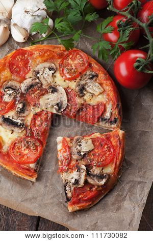 Puff pastry pizza or pie wit tomato, cheese and mushrooms