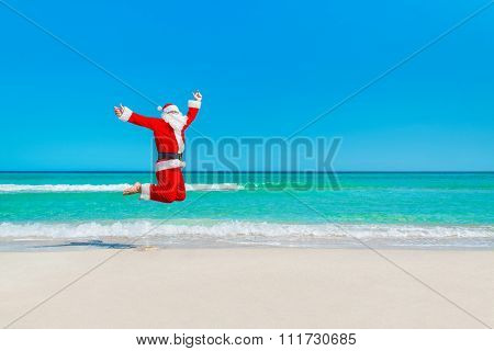 Santa Claus Flying Against Sea Beach And Sky, Christmas Concept