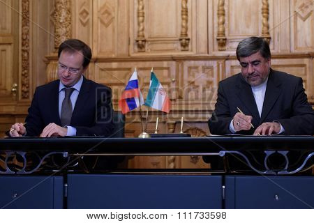 ST. PETERSBURG, RUSSIA - DECEMBER 15, 2015: Russian Minister of culture Vladimir Medinsky  and Iranian Minister of culture and Islamic Guidance Ali Jannati signs the memorandum on cooperation