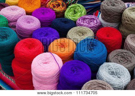 skeins of wool in a street market